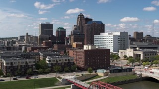 DX0002_165_003 - 5.7K stock footage aerial video the city's skyline seen while passing apartment buildings in Downtown Des Moines, Iowa