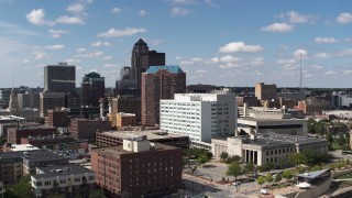 DX0002_165_005 - 5.7K stock footage aerial video the city's skyline seen while ascending past office buildings in Downtown Des Moines, Iowa