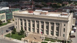 DX0002_165_006 - 5.7K stock footage aerial video orbiting the Des Moines Police Department building in Des Moines, Iowa