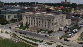 DX0002_165_007 - 5.7K stock footage aerial video orbiting front of the Des Moines Police Department building in Des Moines, Iowa