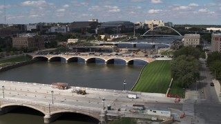 DX0002_165_009 - 5.7K stock footage aerial video of three bridges spanning the river in Des Moines, Iowa