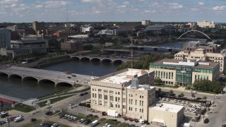 DX0002_165_012 - 5.7K stock footage aerial video approach bridges spanning the river in Des Moines, Iowa