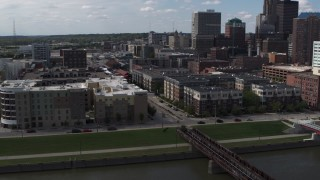 DX0002_165_013 - 5.7K stock footage aerial video orbit hotels and apartment complex, reveal skyline of Downtown Des Moines, Iowa