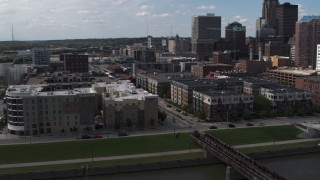 DX0002_165_014 - 5.7K stock footage aerial video orbit hotels and apartment complex near the skyline of Downtown Des Moines, Iowa
