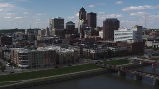 DX0002_165_015 - 5.7K stock footage aerial video slow orbit of hotels and apartment complex, reveal skyline of Downtown Des Moines, Iowa