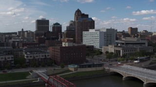 DX0002_165_017 - 5.7K stock footage aerial video descend toward river with view of government offices and skyline, Downtown Des Moines, Iowa