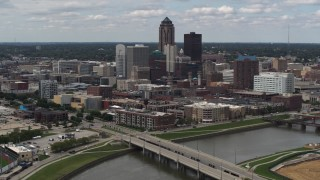 DX0002_165_021 - 5.7K stock footage aerial video of the city's skyline seen from a bridge over the river, Downtown Des Moines, Iowa