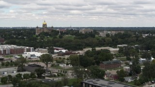 DX0002_165_024 - 5.7K stock footage aerial video of flying away from and by the Iowa State Capitol and grounds in Des Moines, Iowa