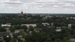 DX0002_165_025 - 5.7K stock footage aerial video of passing by and the approaching the Iowa State Capitol and grounds in Des Moines, Iowa