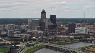 DX0002_165_030 - 5.7K stock footage aerial video of the city's skyline seen from the Cedar River, Downtown Des Moines, Iowa