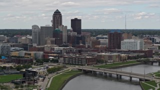 DX0002_165_033 - 5.7K stock footage aerial video of a stationary view of the Cedar River and skyline of Downtown Des Moines, Iowa