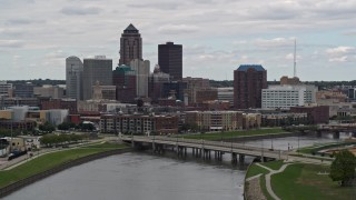 DX0002_165_035 - 5.7K stock footage aerial video of descending past a Cedar River bridge with view of skyline, Downtown Des Moines, Iowa