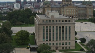 DX0002_166_005 - 5.7K stock footage aerial video orbit a state government building on the capitol grounds in Des Moines, Iowa