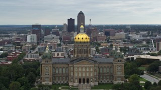 DX0002_166_006 - 5.7K stock footage aerial video of flying by the Iowa State Capitol with a view of the Downtown Des Moines, Iowa skyline