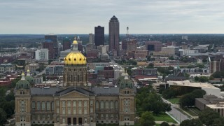DX0002_166_007 - 5.7K stock footage aerial video of a view of the Downtown Des Moines, Iowa skyline seen while passing the capitol
