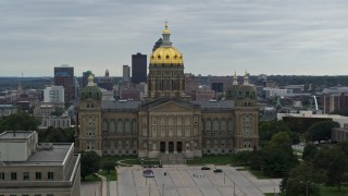 DX0002_166_013 - 5.7K stock footage aerial video circling around the front of the Iowa State Capitol, skyline in the background, Des Moines, Iowa