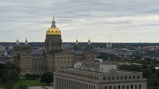 DX0002_166_014 - 5.7K stock footage aerial video ascend by government office building for view of the Iowa State Capitol, Des Moines, Iowa
