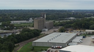 DX0002_166_024 - 5.7K stock footage aerial video of a grain elevator and warehouse building in Des Moines, Iowa