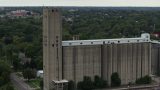 DX0002_166_025 - 5.7K stock footage aerial video a reverse view of a grain elevator in Des Moines, Iowa