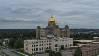 DX0002_166_027 - 5.7K stock footage aerial video stationary view of the Iowa State Capitol behind government building, Des Moines, Iowa
