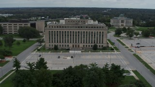 DX0002_166_031 - 5.7K stock footage aerial video orbit and fly away from a state government office building, Des Moines, Iowa