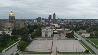 DX0002_166_034 - 5.7K stock footage aerial video reverse view of distant skyline seen from the state library and capitol, Downtown Des Moines, Iowa