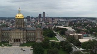 DX0002_166_038 - 5.7K stock footage aerial video of flying away from the distant skyline and reveal the capitol building, Des Moines, Iowa