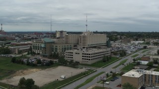 DX0002_166_043 - 5.7K stock footage aerial video of ascending away from a hospital in Des Moines, Iowa