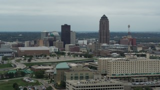 DX0002_167_003 - 5.7K stock footage aerial video of a reverse view of the city's skyline and skyscraper in Downtown Des Moines, Iowa, reveal hospital
