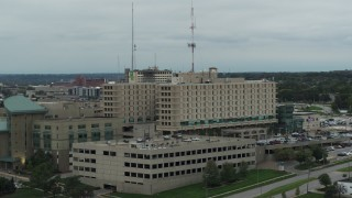 DX0002_167_006 - 5.7K stock footage aerial video fly away from a hospital in Des Moines, Iowa