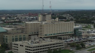 DX0002_167_009 - 5.7K stock footage aerial video approach and orbit side of a hospital in Des Moines, Iowa