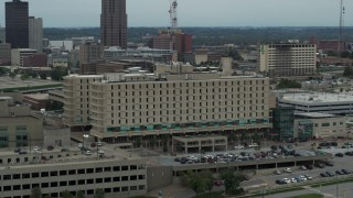 DX0002_167_010 - 5.7K stock footage aerial video orbit top floors of a hospital in Des Moines, Iowa