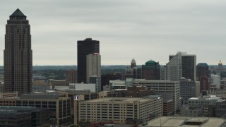 DX0002_167_014 - 5.7K stock footage aerial video flyby and away from skyscraper and office buildings in Downtown Des Moines, Iowa