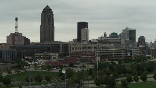 DX0002_167_016 - 5.7K stock footage aerial video of a towering skyscraper and office buildings in Downtown Des Moines, Iowa