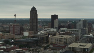 DX0002_167_019 - 5.7K stock footage aerial video passing by a towering skyscraper and office buildings in Downtown Des Moines, Iowa