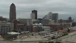 DX0002_167_032 - 5.7K stock footage aerial video fly away from office buildings and a skyscraper in Downtown Des Moines, Iowa