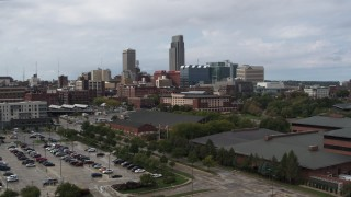DX0002_168_007 - 5.7K stock footage aerial video descend with view of the downtown skyline in Downtown Omaha, Nebraska