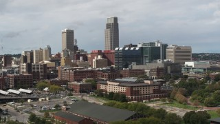 DX0002_168_010 - 5.7K stock footage aerial video of passing by skyscraper and downtown skyline in Downtown Omaha, Nebraska