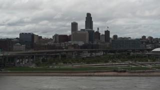 DX0002_168_014 - 5.7K stock footage aerial video ascend from Missouri River toward the city skyline, Downtown Omaha, Nebraska