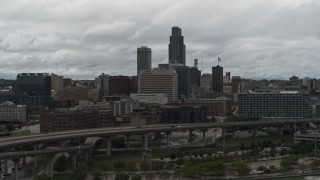 DX0002_168_015 - 5.7K stock footage aerial video flyby and away from the city skyline, seen from the river, Downtown Omaha, Nebraska