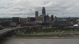 DX0002_168_017 - 5.7K stock footage aerial video of the city skyline and park across the river, Downtown Omaha, Nebraska