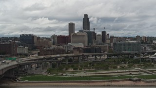 DX0002_168_019 - 5.7K stock footage aerial video of a reverse view of the city skyline from riverfront park, Downtown Omaha, Nebraska