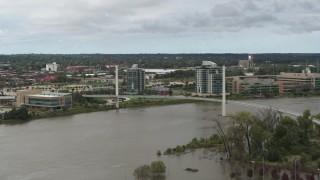 DX0002_168_020 - 5.7K stock footage aerial video of a pedestrian bridge spanning the Missouri River, Omaha, Nebraska
