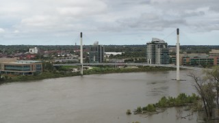 DX0002_168_021 - 5.7K stock footage aerial video of flying by a pedestrian bridge spanning the Missouri River, Omaha, Nebraska