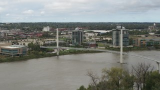 DX0002_168_022 - 5.7K stock footage aerial video of passing a pedestrian bridge spanning the Missouri River, Omaha, Nebraska