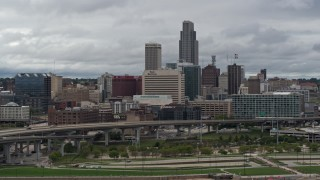 DX0002_169_001 - 5.7K stock footage aerial video of the city skyline seen from riverfront park, Downtown Omaha, Nebraska