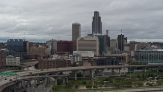 DX0002_169_003 - 5.7K stock footage aerial video of passing a riverfront park with a view of skyline, Downtown Omaha, Nebraska
