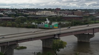 DX0002_169_010 - 5.7K stock footage aerial video of light traffic crossing the I-480 bridge, Omaha, Nebraska
