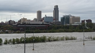 DX0002_169_022 - 5.7K stock footage aerial video of Missouri River and riverfront park with view of skyline, Downtown Omaha, Nebraska