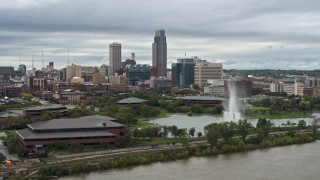 DX0002_169_029 - 5.7K stock footage aerial video a view of the city's skyline behind a park fountain, Downtown Omaha, Nebraska